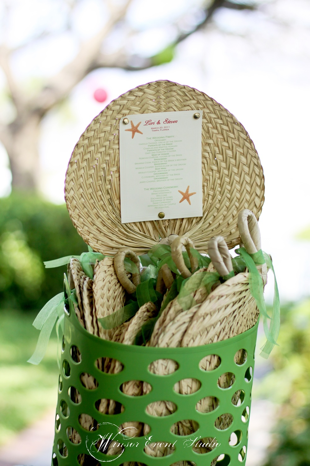 Woven raffia fans doubled as ceremony programs