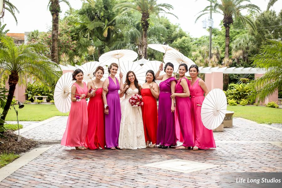 The bridesmaids wore chiffon gowns in varying shades of pink, purple, and red