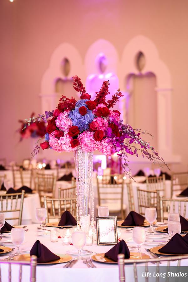 Tall centerpieces of colorful hydrangea, roses, and orchids were accented with strands of crystals