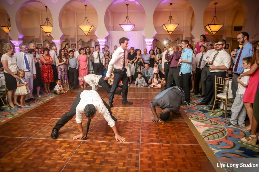 The groom and his entourage entertained the guests with impromptu breakdancing