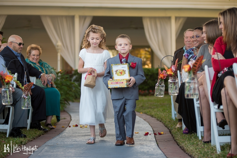 The ring bearer carried the rings in a cigar box