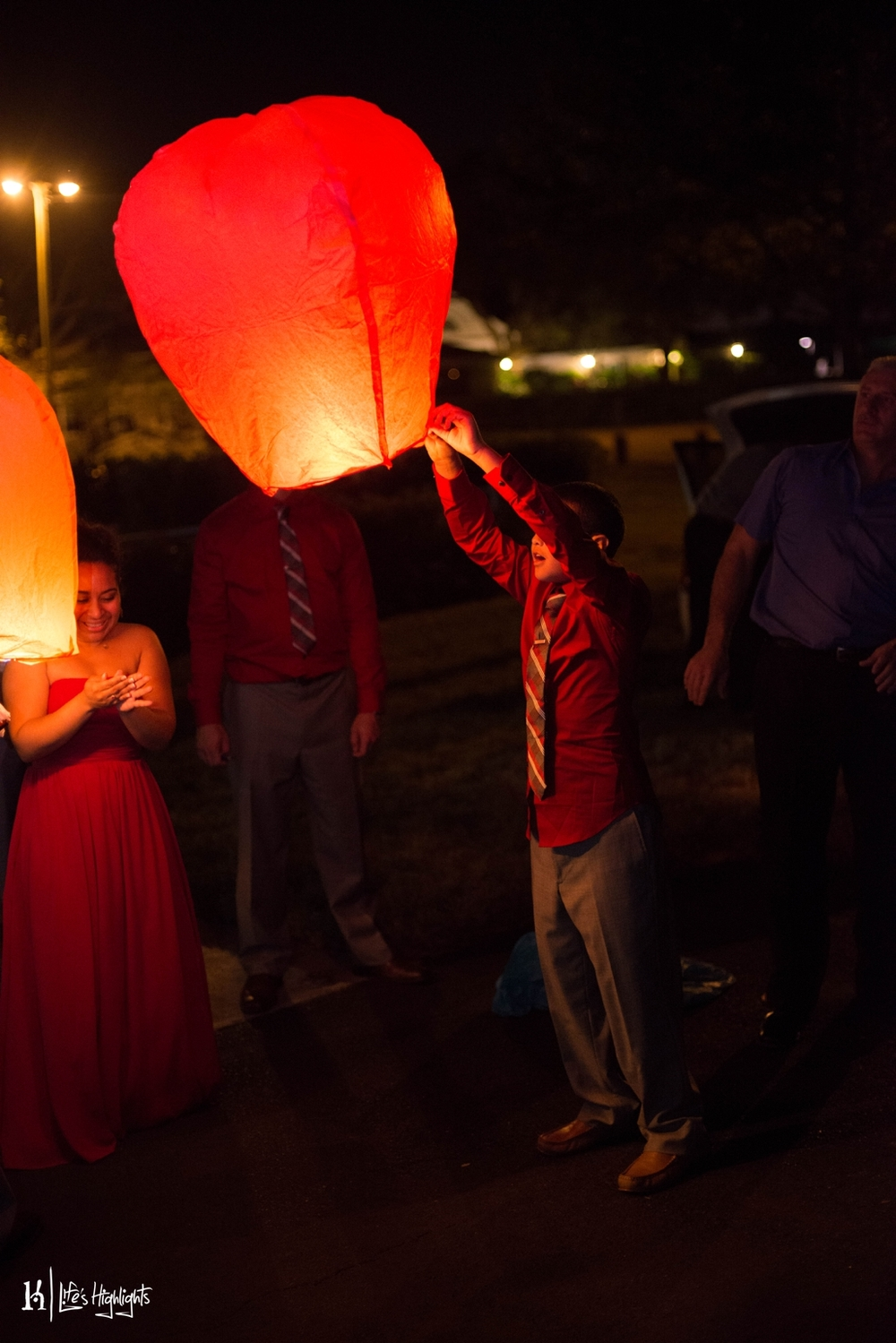 Guests released sky lanterns into the night sky as a symbol of well wishes for the bride and groom