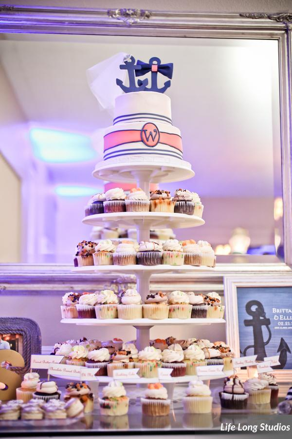 A tower of cupcakes was topped with a petite nautical cake for the couple to ceremoniously cut