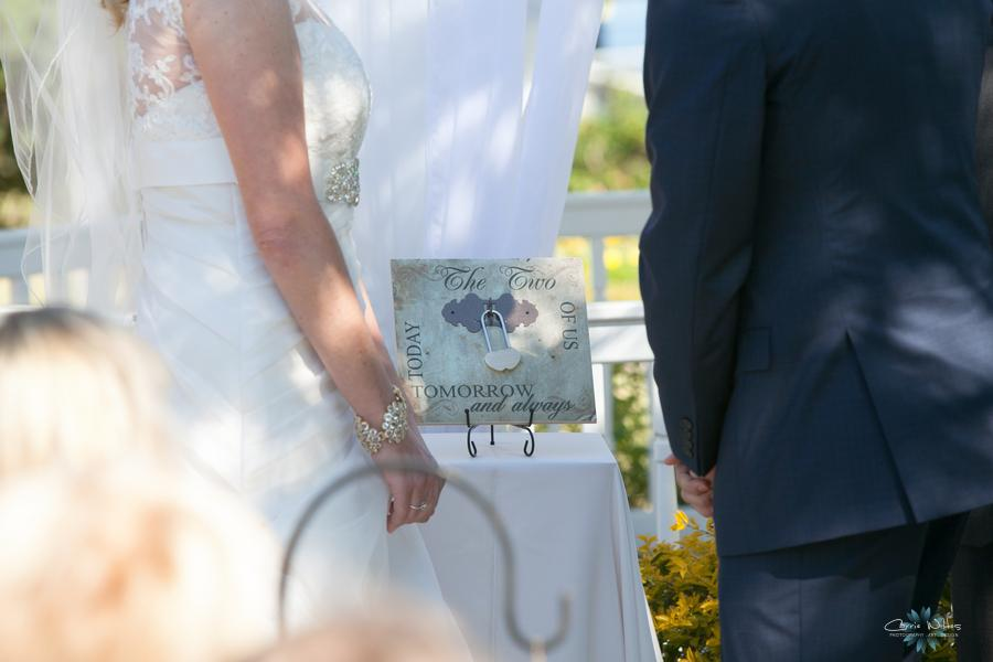 The bride and groom secured an engraved lock onto a keepsake display as a unique unity ceremony
