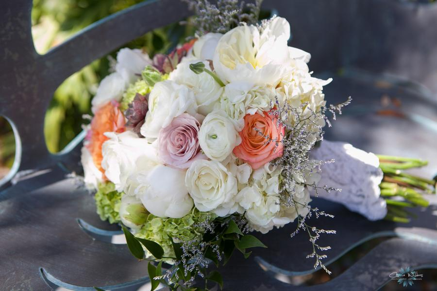 The bride's bouquet featured hydrangea, roses, renunculus, peonies, & tulips in shades of ivory, peach, and citron