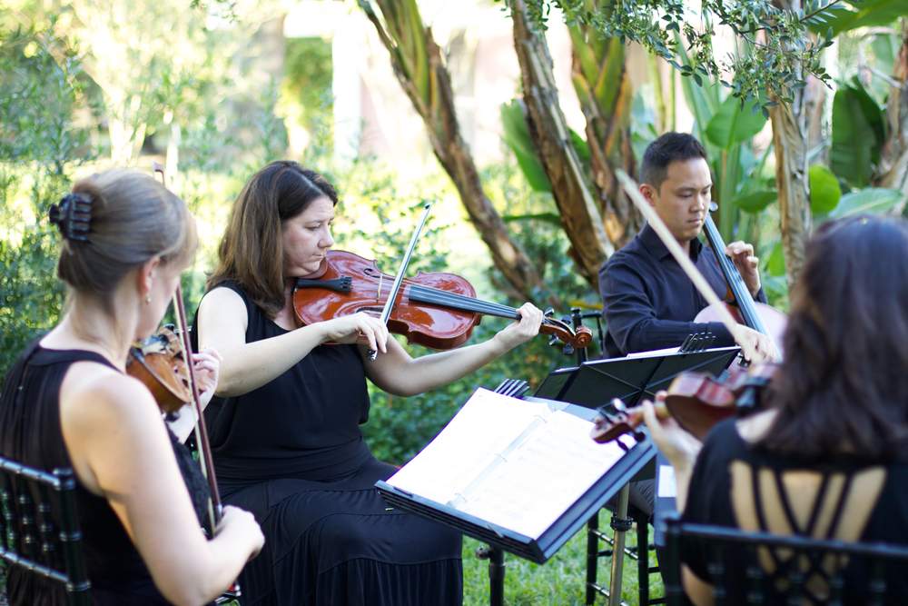 A string quartet played softly during the processional
