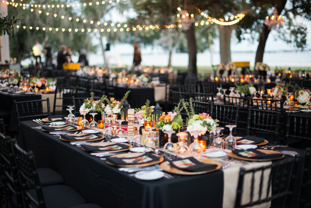 Feasting tables were nestled under a canopy of tree branches and string lights