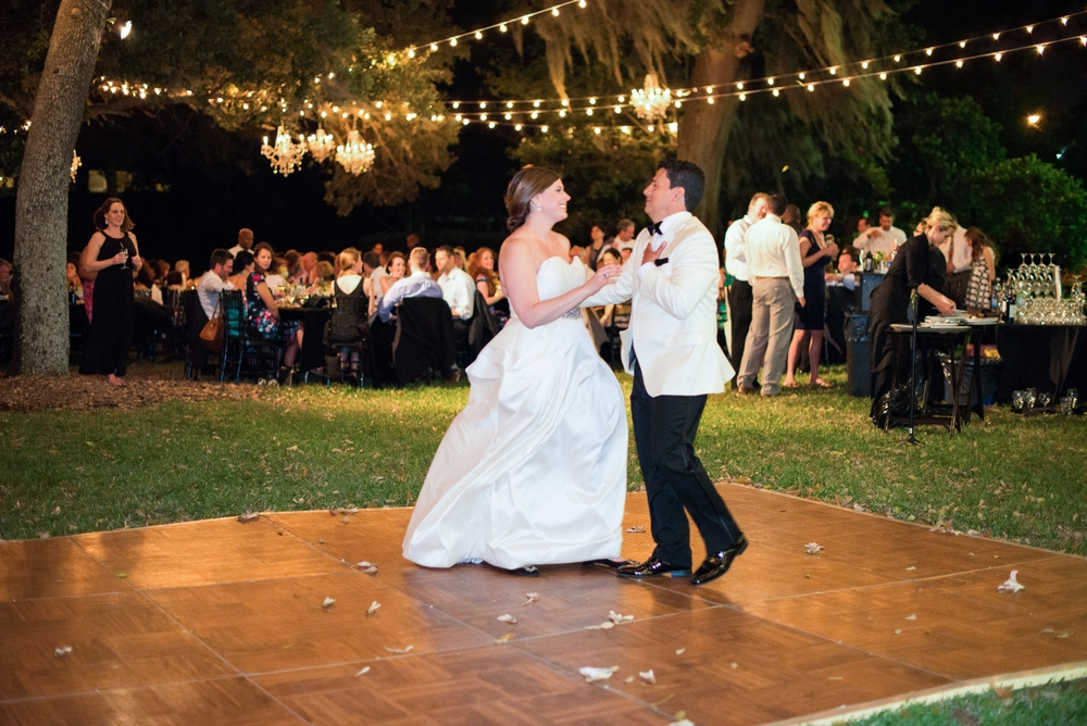 The couple shared their first dance on an outdoor dance floor, performed by a live band