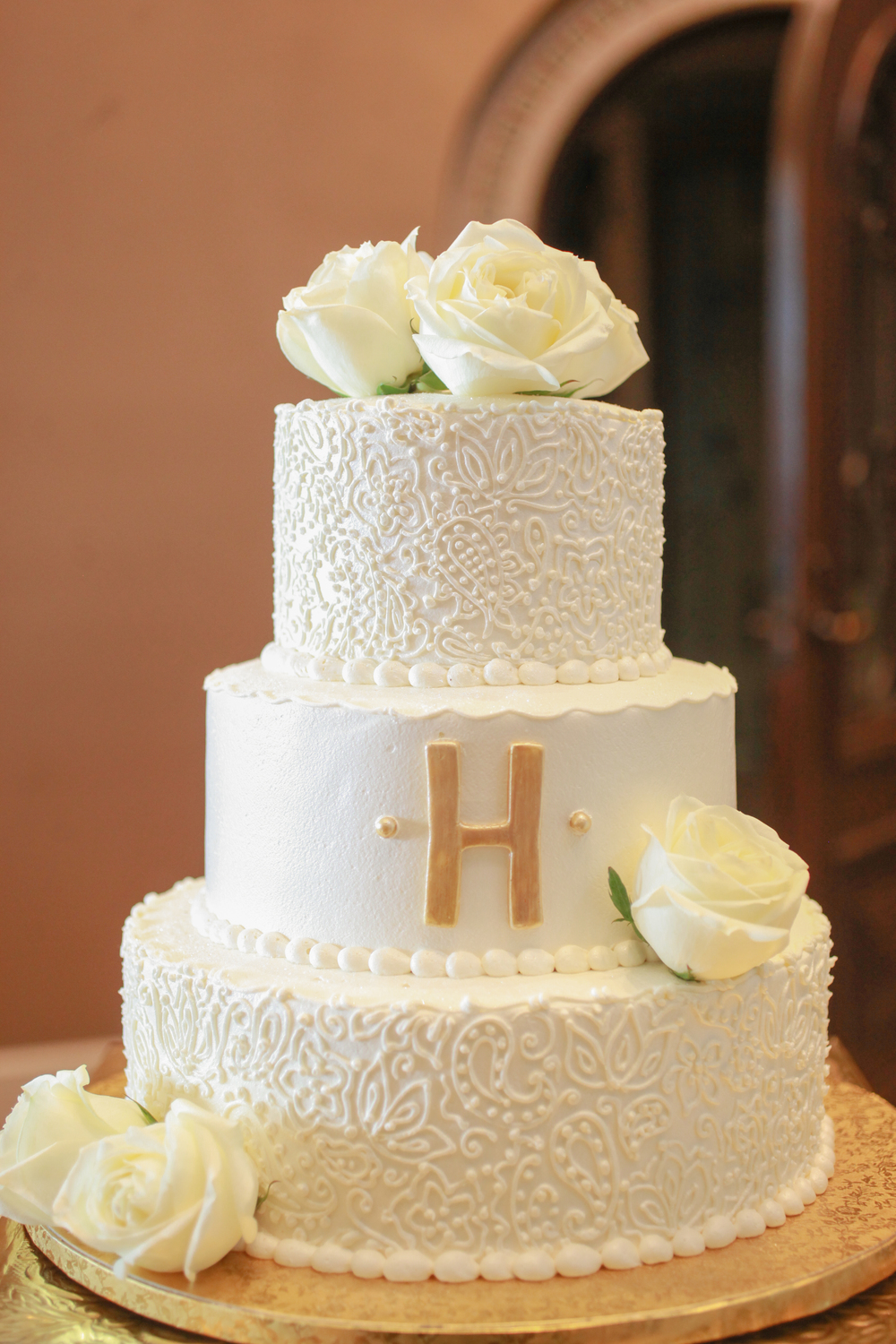 winsor event studio gold monogram wedding cake