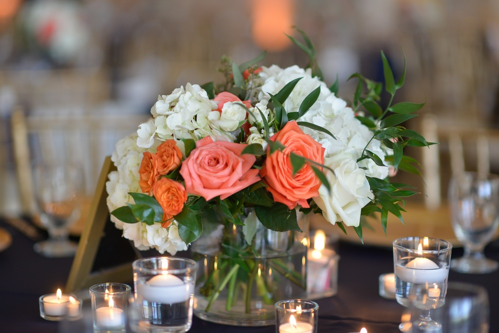 winsor event studio coral peach centerpiece navy wedding