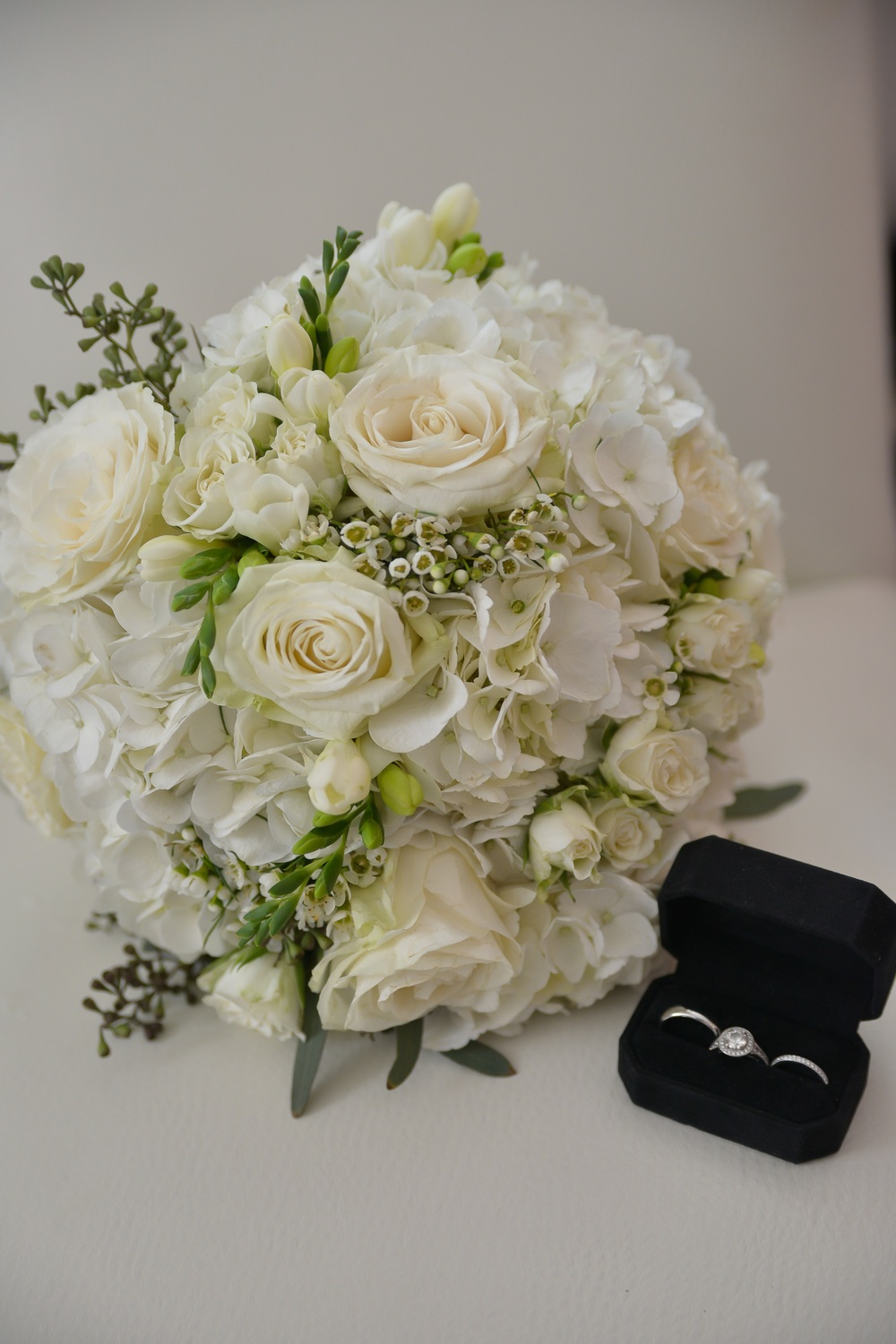 winsor event studio ivory bouquet hydrangea roses freesia waxflower