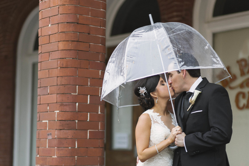 winsor event studio bride groom umbrella wedding rain