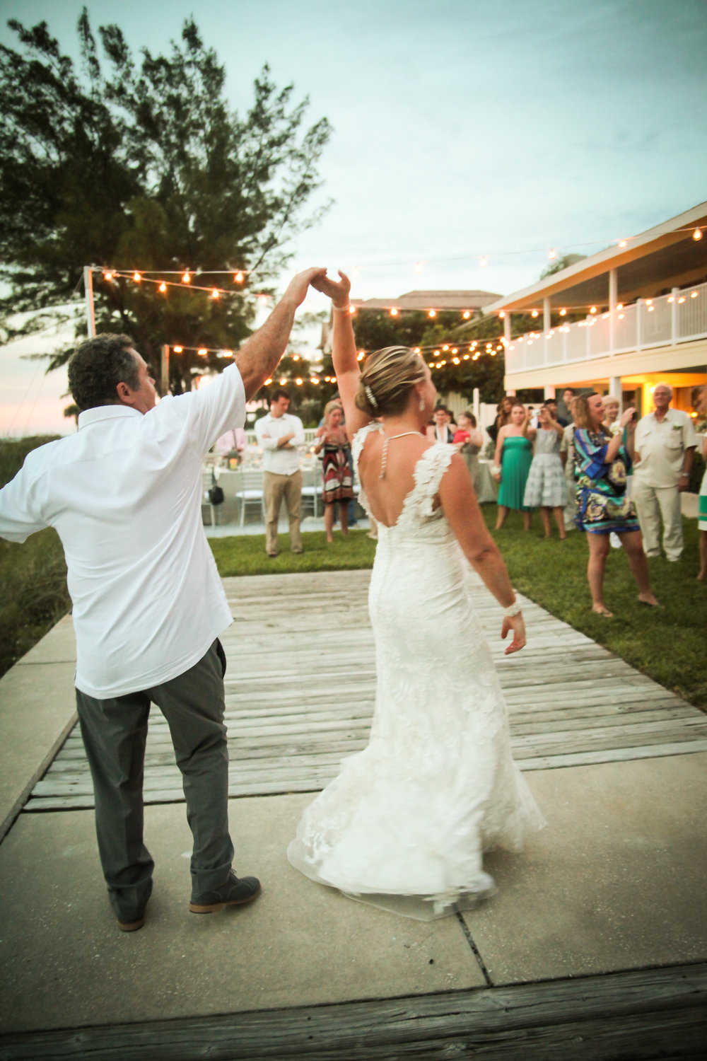 winsor event studio beach wedding canopy string lights dance floor