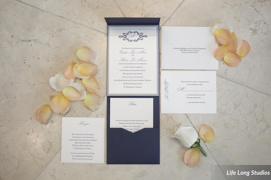 This pocket-style invitation suite featured navy and silver papers and inks plus a custom monogram