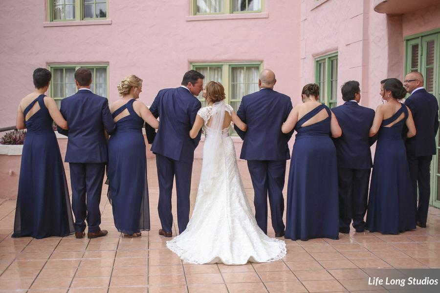 The wedding party wore classic navy suits and chiffon gowns