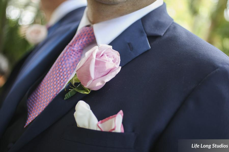A navy suit with pink tie and blush rose boutonniere is such a stunning combination!