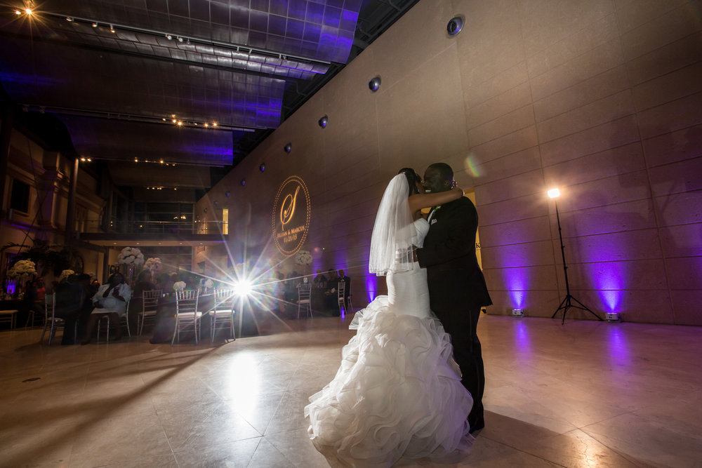 Colorful uplighting and a custom monogram GOBO dressed up the expansive reception walls.