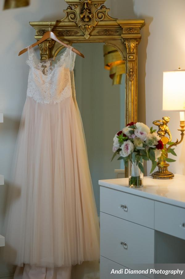 The bride customized her wedding gown with added lace appliques and a sheer tulle neckline.