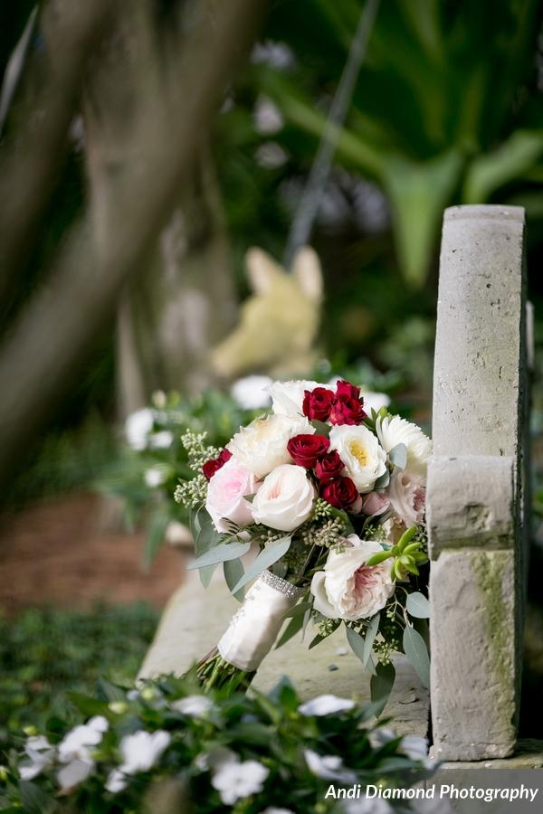 The bride's bouquet featured garden roses, tea roses, succulents, and eucalyptus in shades of ivory, blush, and deep red.