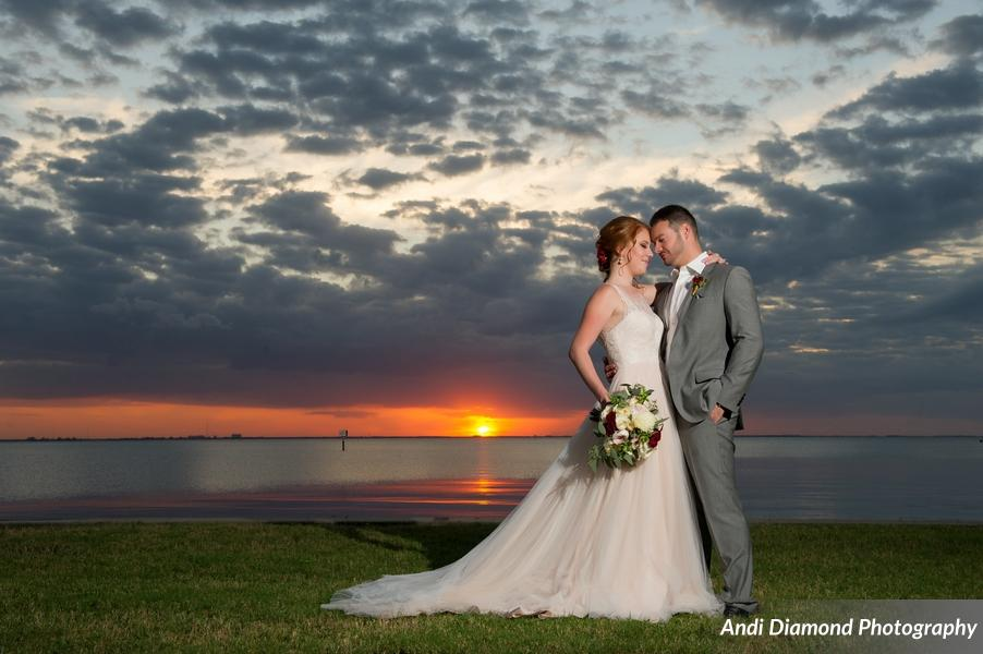 The family home, located along the mouth of Tampa Bay, was graced by a stunning sunset - the bride and groom's portraits were seriously like a dream!