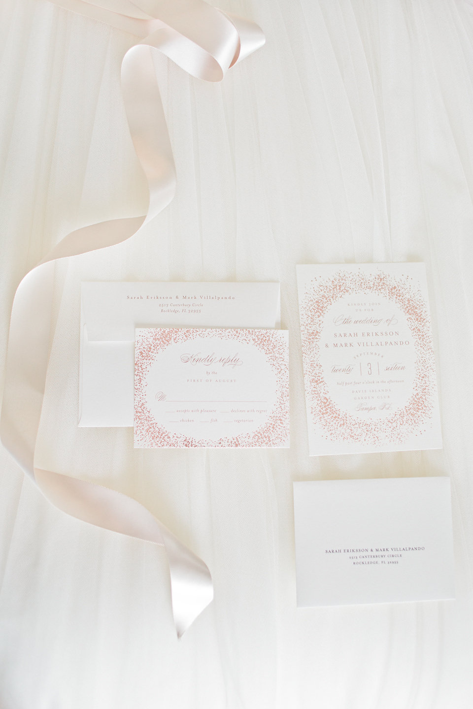The invitation suite design featured a burst of rose gold foil.