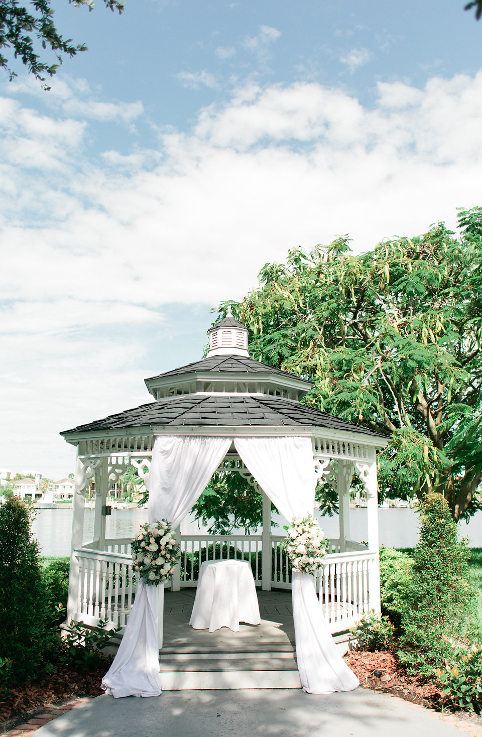 The garden gazebo was dressed with soft flowing fabric and floral tie backs.