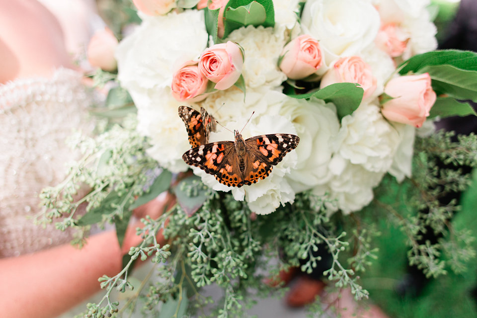 The garden-inspired bouquet was an inviting resting place for a few butterflies.