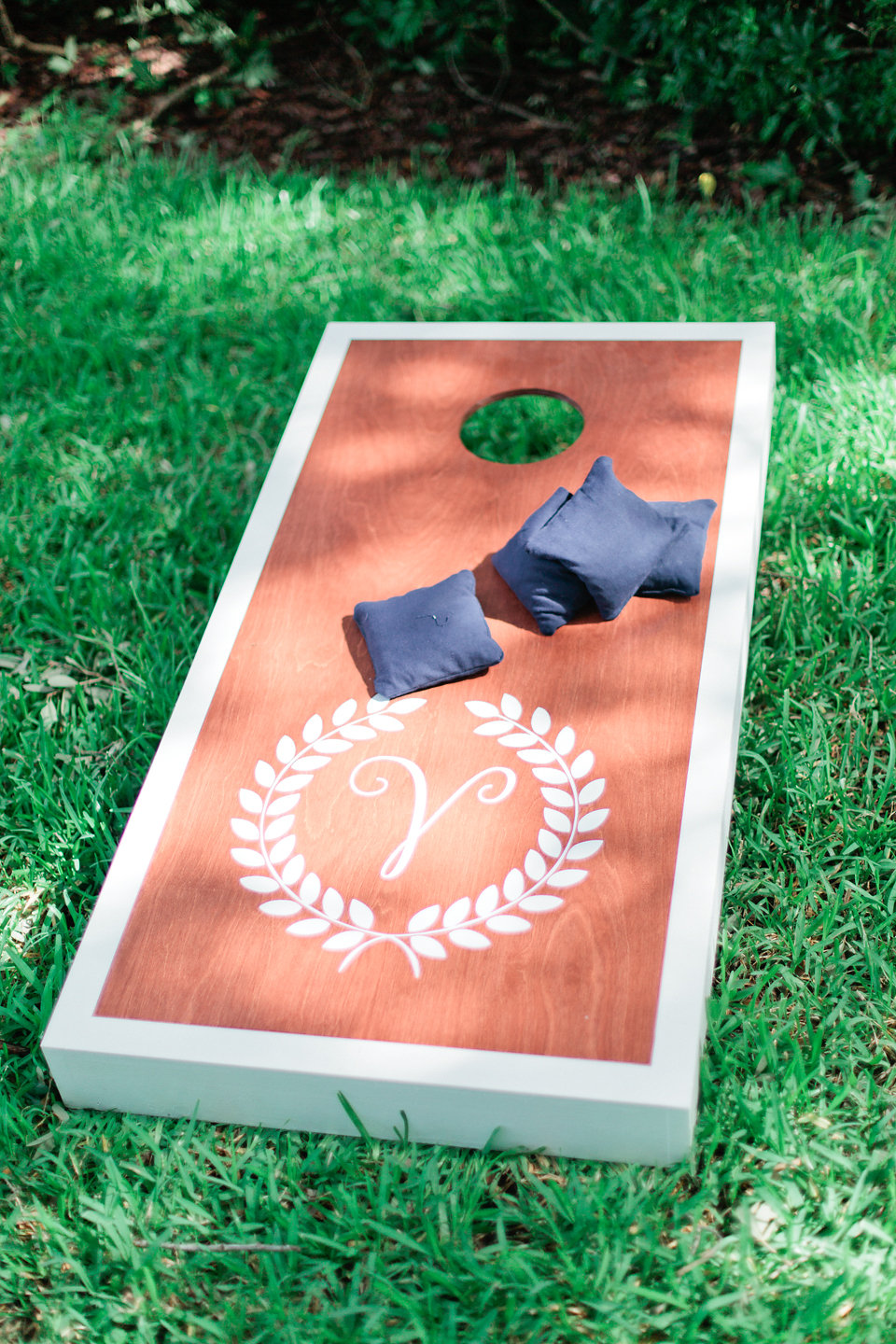 Guests enjoyed lawn games during the cocktail hour, including these monogrammed corn hole boards.
