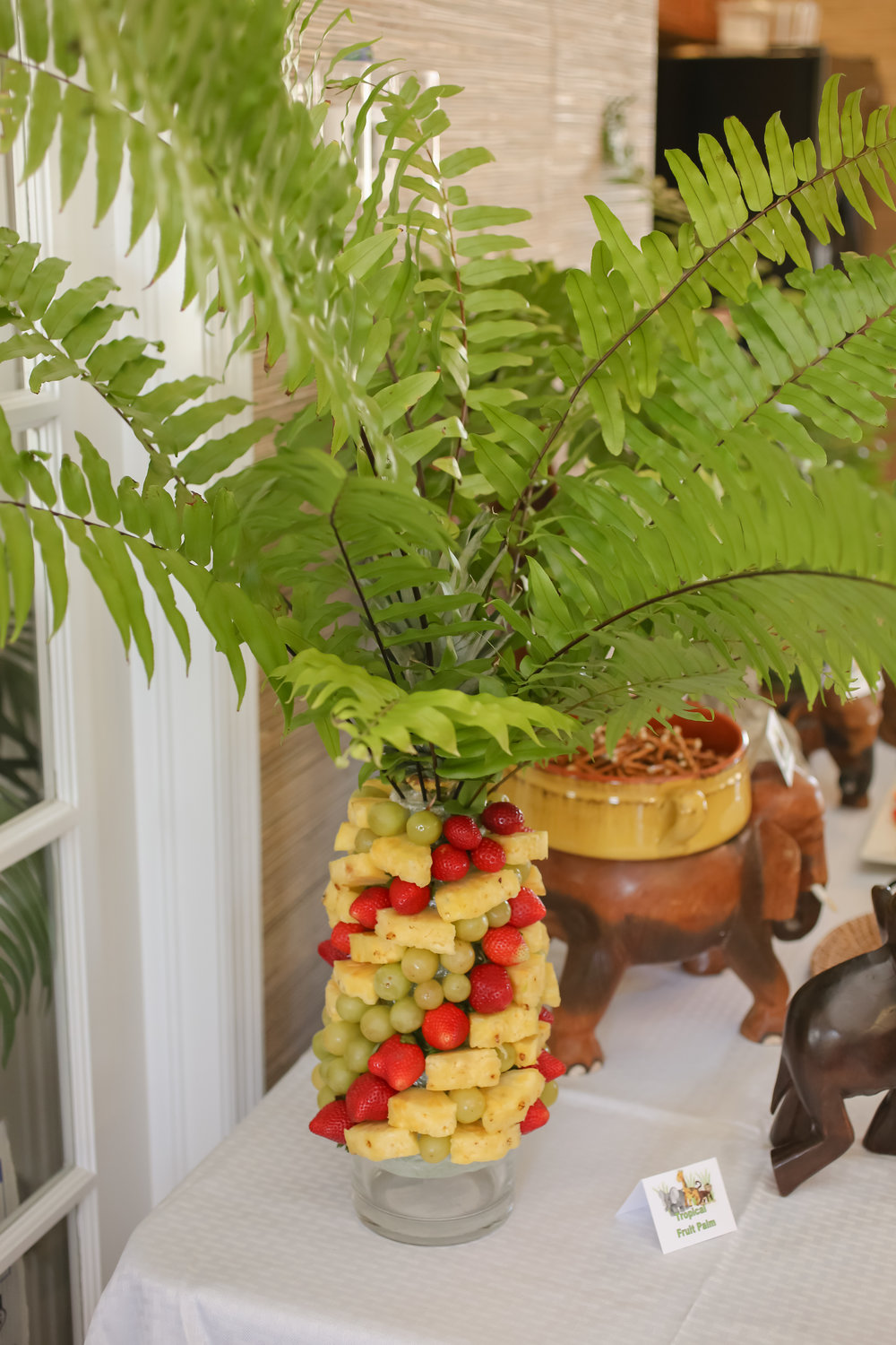 A towering 'Tropical Fruit Palm' added some color and sweetness to the food station!