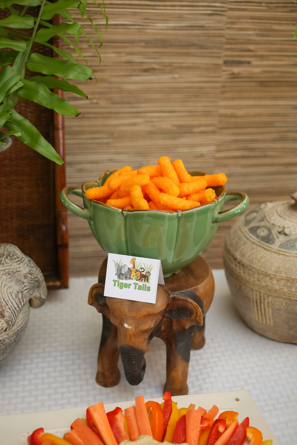 Adorable elements like wooden elephant stands helped complete the jungle themed food station.
