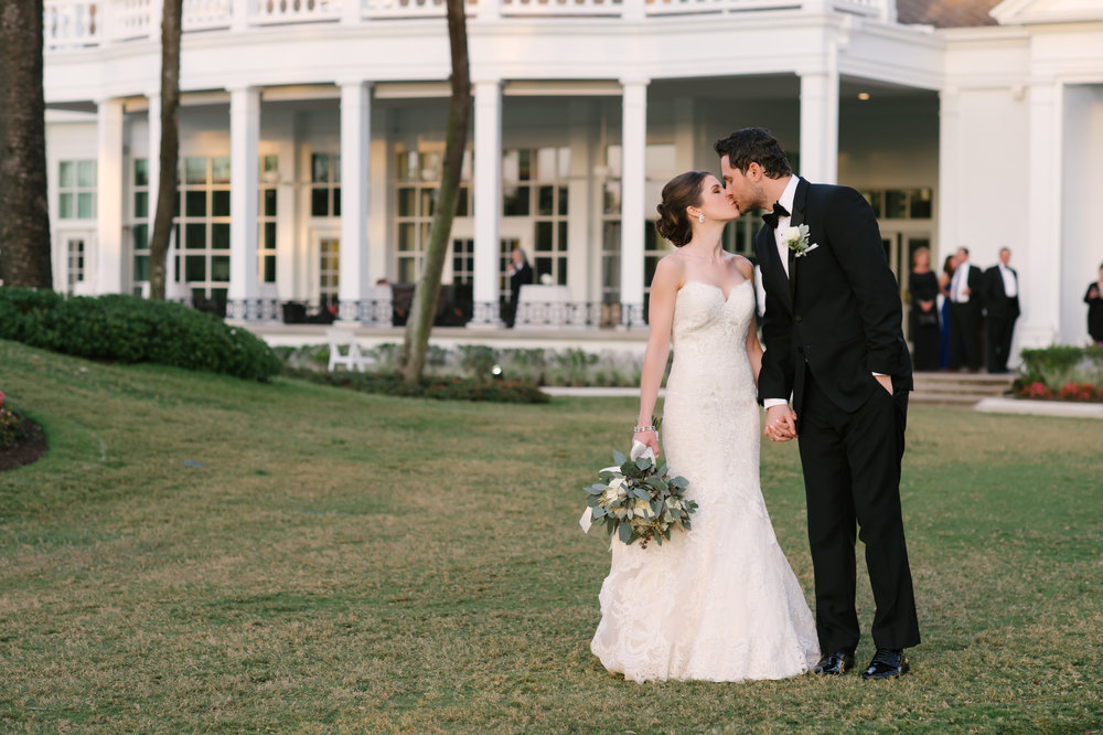 The couple looked stunning in their classic and elegant attire on the green of the Palma Ceia Golf and Country Club.