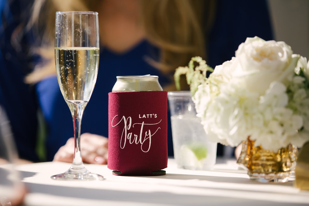 "Cocktails were tucked into custom koozie favors that read ""Latt's Party!"""