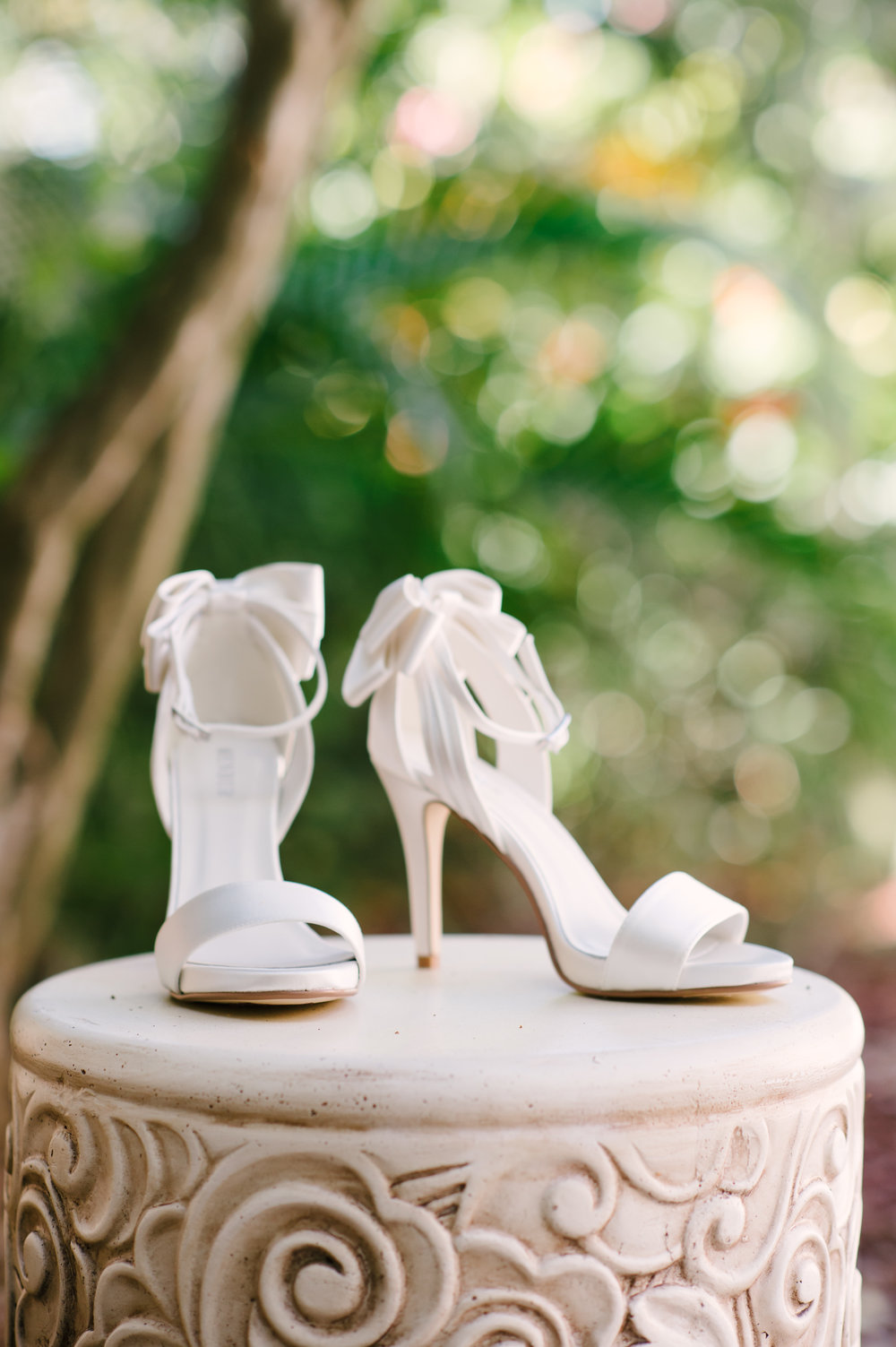 The bride's ivory heels with elegant bow details on the backs.