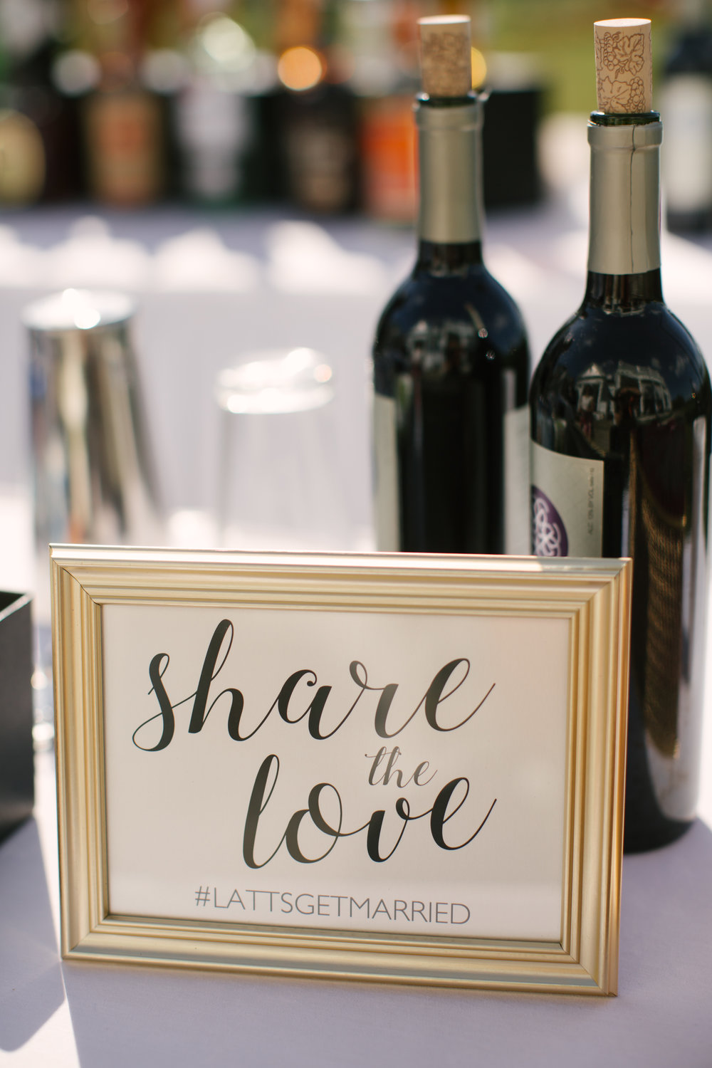 The couple's custom wedding hashtag in a gold framed sign on the bar.