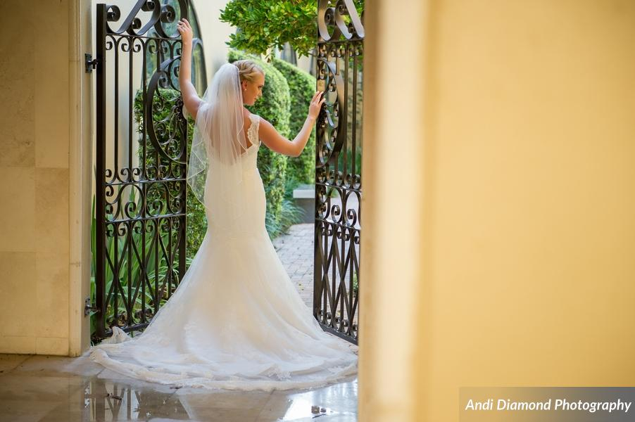 The bride looked simply gorgeous in her lace mermaid fit gown and fingertip length veil.