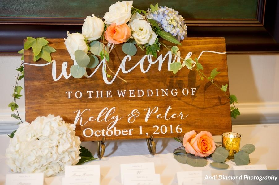 A custom welcome sign greeted guests at the escort card display.