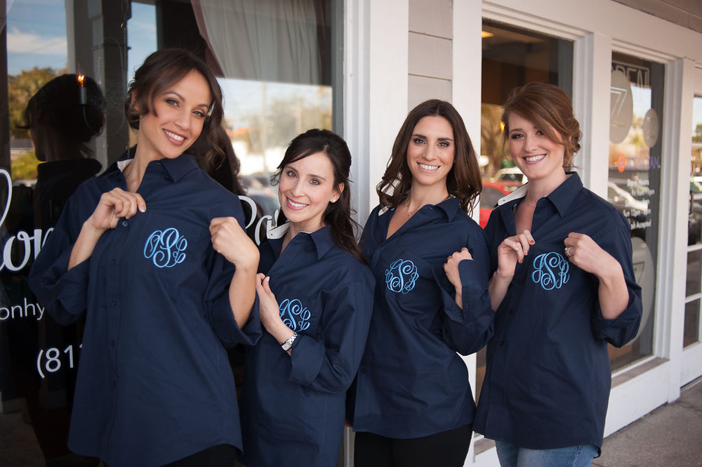 The bridesmaids showing off their custom monogrammed button down shirts in navy and Carolina blue, to compliment the wedding colors.