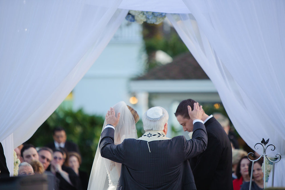 A moving moment as the Rabbi blesses the couple during the ceremony.