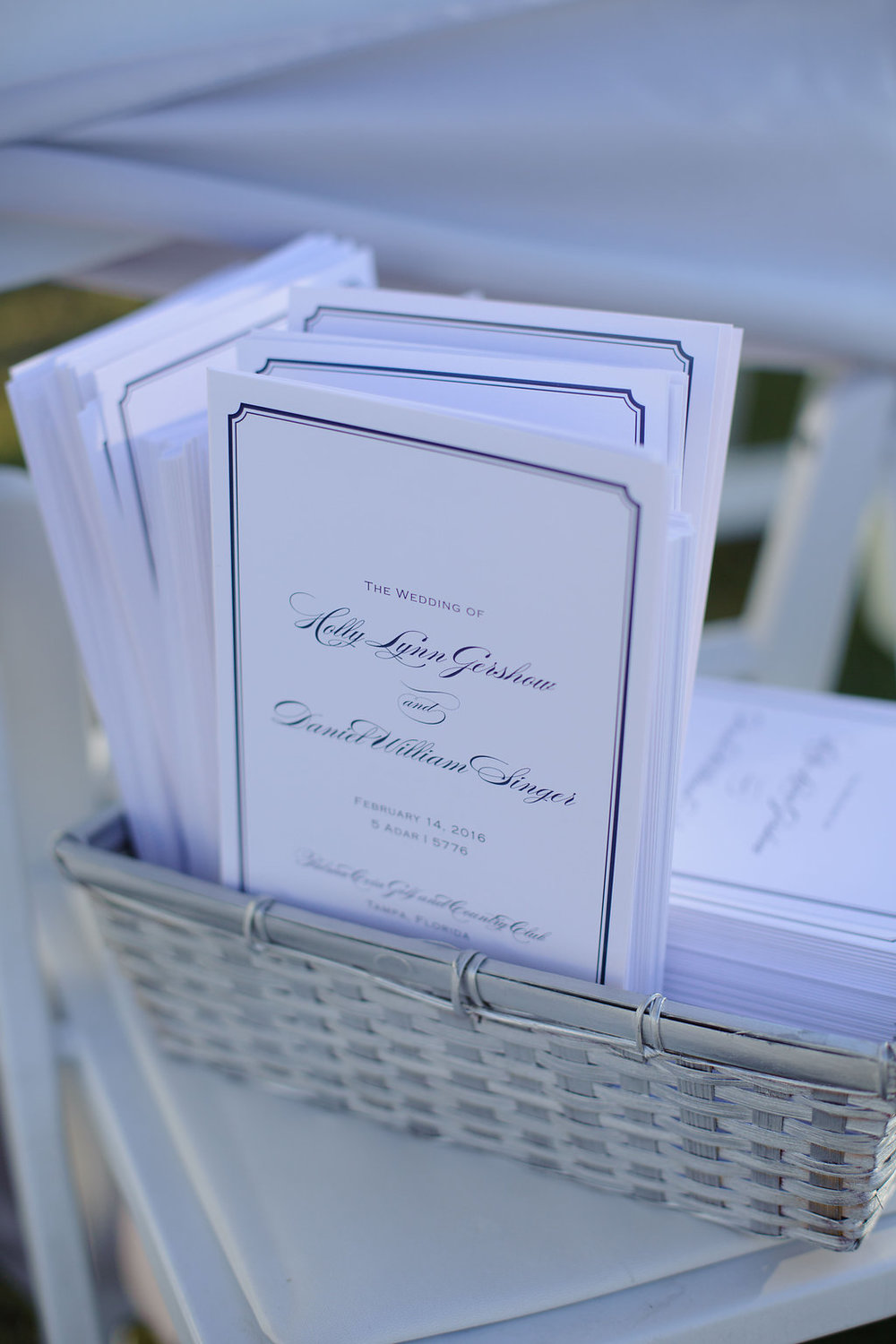 Custom Crane ceremony programs, with the same beautiful navy script as the invitations, were provided to guests during the ceremony.