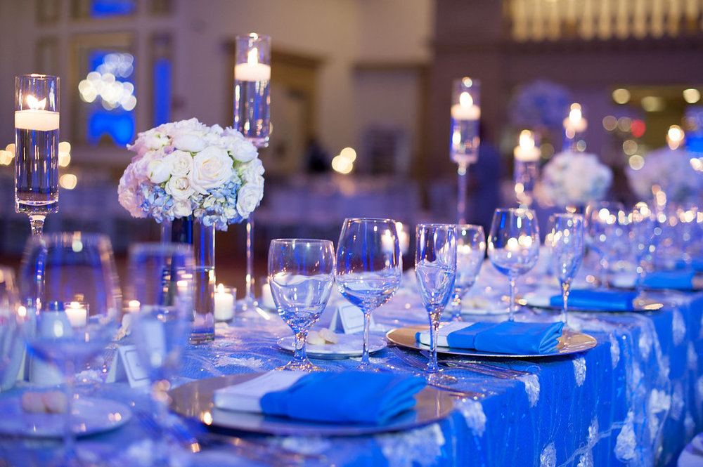 A large feasting table was filled with flowers and candlelight for the wedding party.