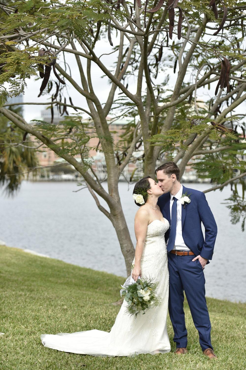 The couple under the waterfront Orange Mimosa tree at Davis Islands Garden Club.