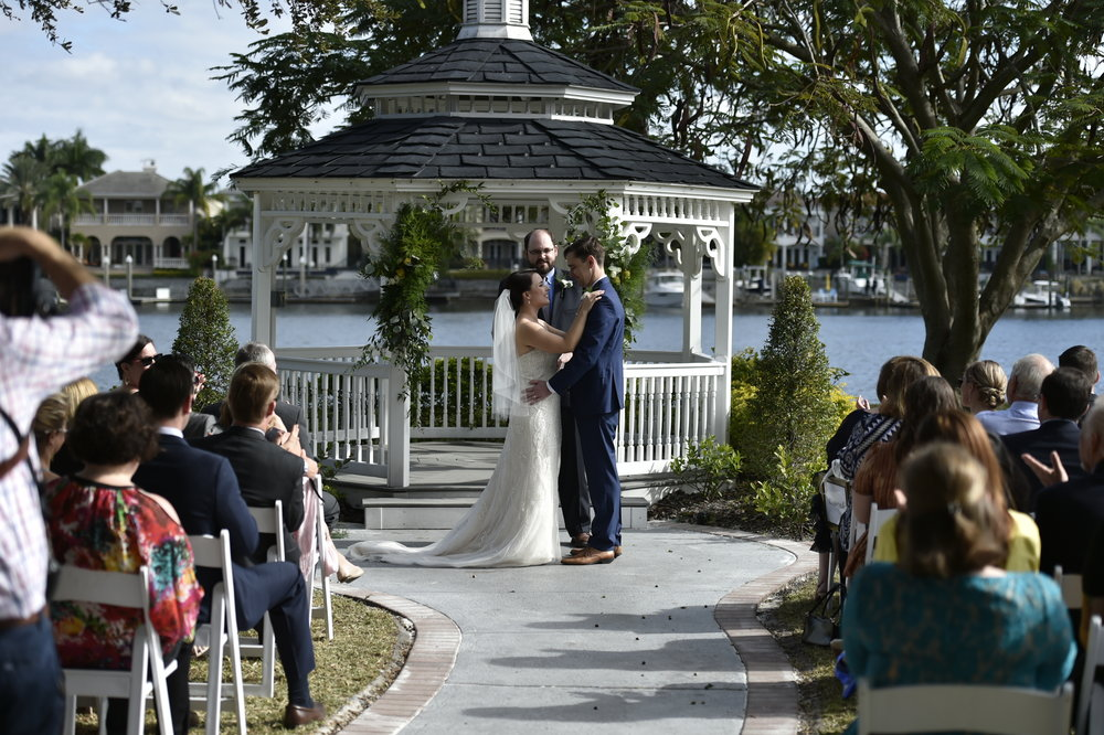 The gazebo was simply decorated for this early morning ceremony, with feathery greens and neutral flower blooms.