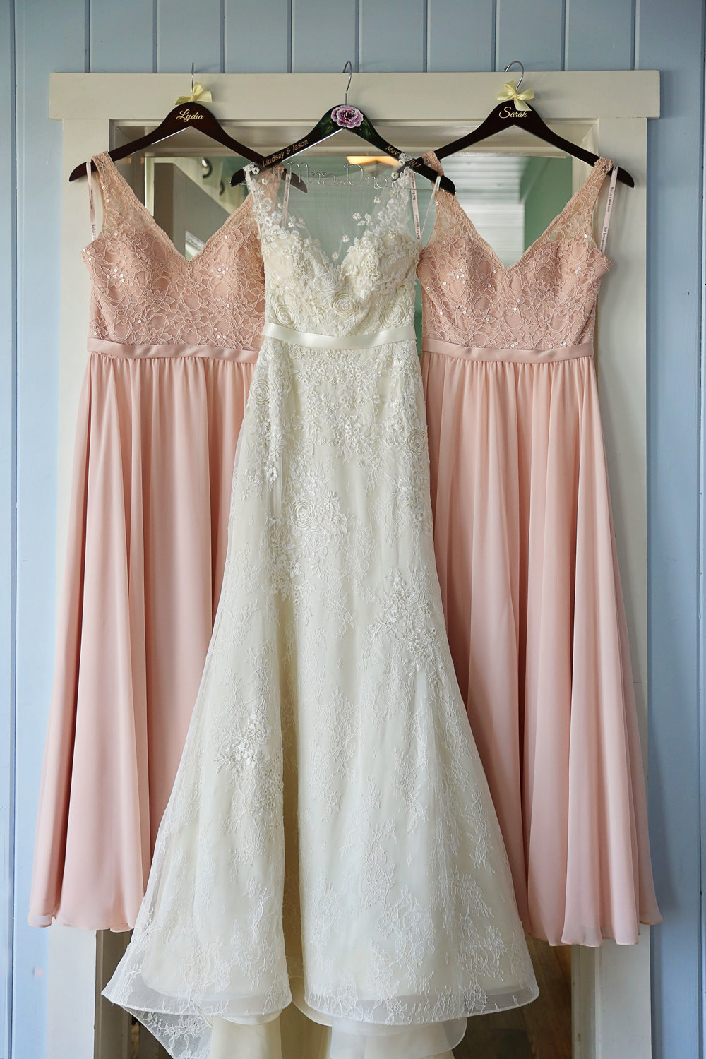 Shell Pink bridesmaids dresses accented the brides lace appliqué embroidered, illusion neckline gown.