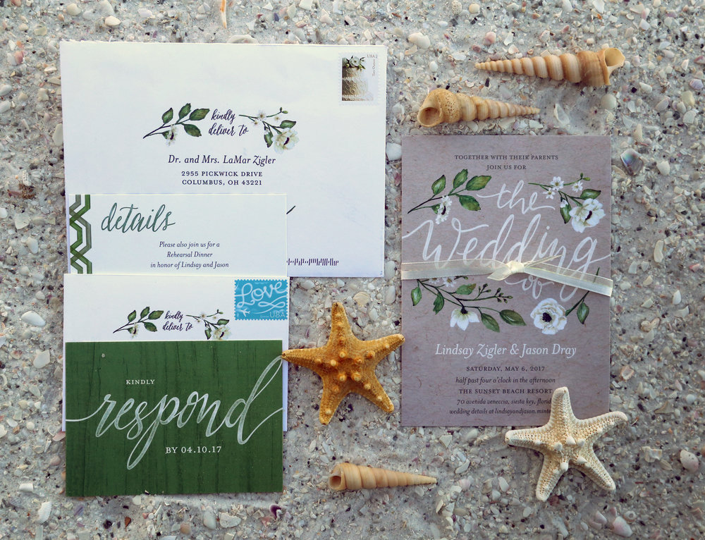 A greenery and floral motif was found throughout many details of the wedding, including this gorgeous invitation suite, inspired by the couple's love of nature and the outdoors.