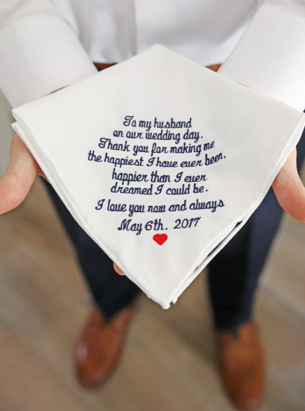As a super sweet gift, the bride embroidered a message to her husband-to-be on a handkerchief he could carry with him down the aisle.