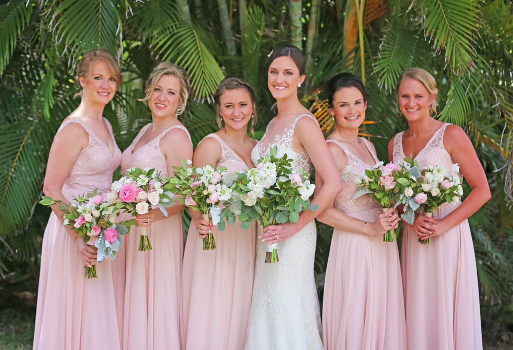 The bride and her girls looked gorgeous, with the bridesmaids in matching shell pink dresses with lace accents.