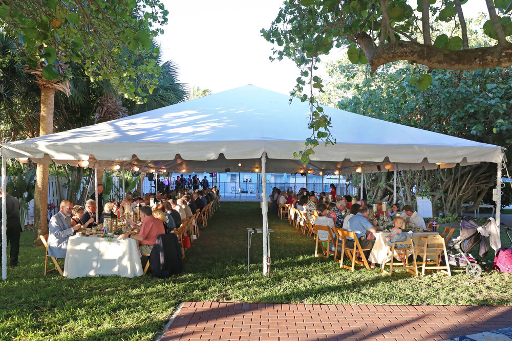For the reception guests sat at large feasting tables beneath a tent and romantic string lights