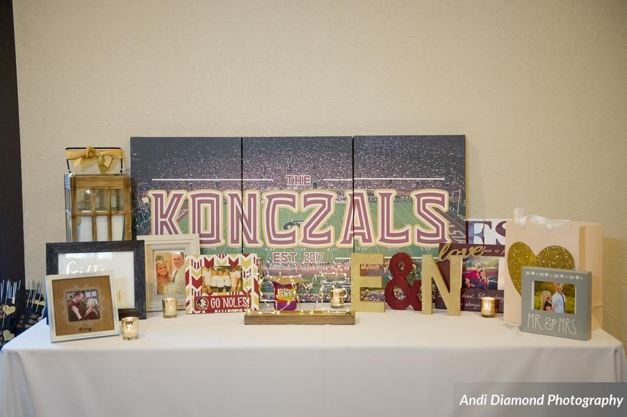 The gift table was full of pictures of the couple and amazing personalized gifts, like the three paneled canvas prints of the couple's last name against an image of the FSU stadium.
