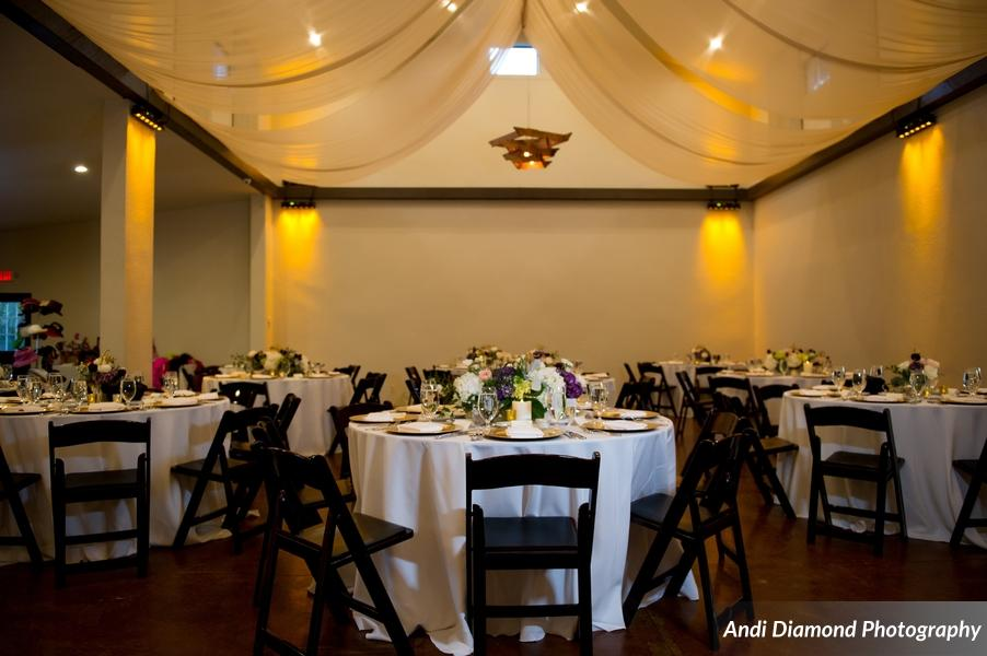 The reception space had an intimate and romantic feel thanks to soft ceiling draping and amber up-lighting.