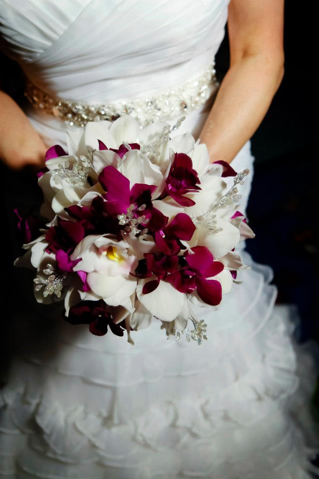 The bride's bouquet was a mixture of purple and white orchids with vintage inspired crystal pieces throughout.